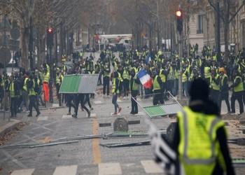 شعار الشعب يريد إسقاط النظام يظهر بشوارع باريس