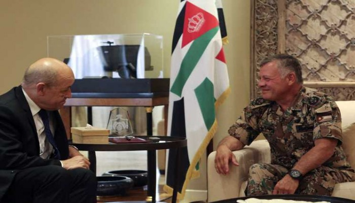 عاهل الأردن ووزير الخارجية الفرنسي يبحثان أزمات المنطقة