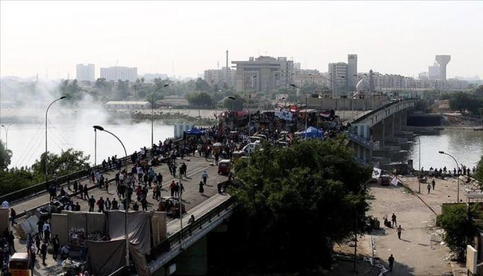 حالات اختناق في تفريق الشرطة لمحتجين قرب جسر الأحرار ببغداد