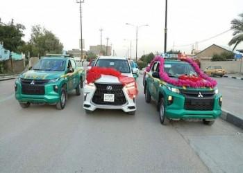بسبب كورونا.. الشرطة العراقية تزف عروسين بسياراتها في الديوانية